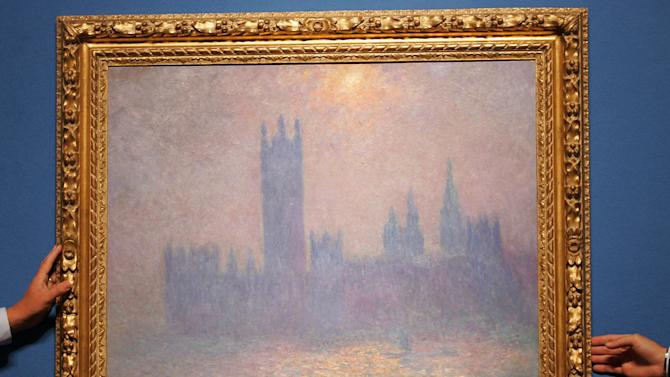 """FILE - This Wednesday, Sept 29, 2004 file photo shows a painting by French impressionist Claude Monet entitled """"Londres, le Parlement, effet de soleil dans le brouillard"""" or """"Houses of Parliament, London, effect of the sun in the fog,"""" painted in 1904 at Christie's auction house in London. (AP Photo/Alastair Grant)"""