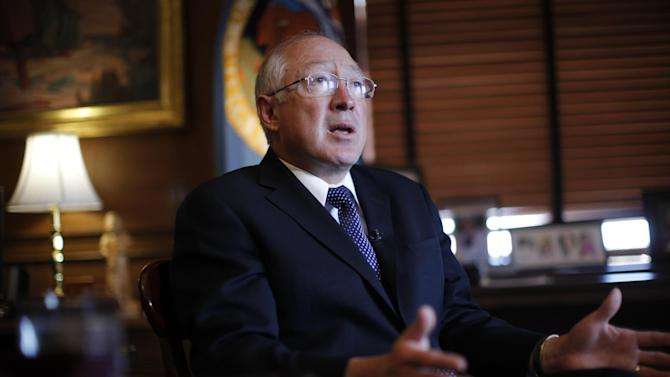 Outgoing Interior Secretary Ken Salazar gestures during an interview with The Associated Press in his office at the Interior Department in Washington, Friday, April 5, 2013. (AP Photo/Charles Dharapak)