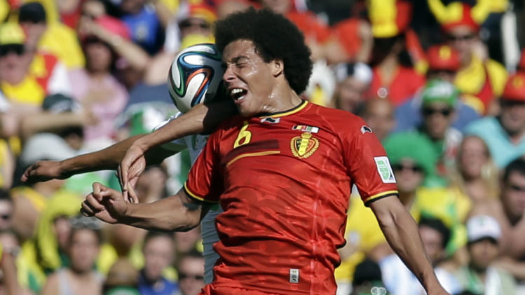 Belgium's Axel Witsel wins a header during the group H World Cup soccer match between Belgium and Algeria at the Mineirao Stadium in Belo Horizonte, Brazil, Tuesday, June 17, 2014