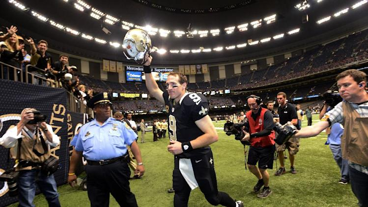 New Orleans Saints quarterback Drew Brees (9) walks off the field after their 28-13 win over the Philadelphia Eagles in an NFL football game at Mercedes-Benz Superdome in New Orleans, Monday, Nov. 5, 2012. (AP Photo/Bill Feig)