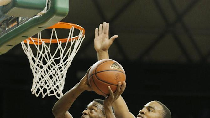 Kansas Elijah Johnson (15), left, drives on Baylor's Rico Gathers (2), right, in the first half of a NCAA basketball game, Saturday,  March 9,  2013, in Waco, Texas. (AP Photo/Waco Tribune Herald, Rod Aydelotte)