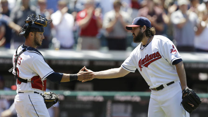 Cleveland Indians relief pitcher Chris Perez, right, is congratulated by catcher Yan Gomes after the Indians defeated the Toronto Blue Jays 4-2 in a baseball game, Thursday, July 11, 2013, in Cleveland. (AP Photo/Tony Dejak)