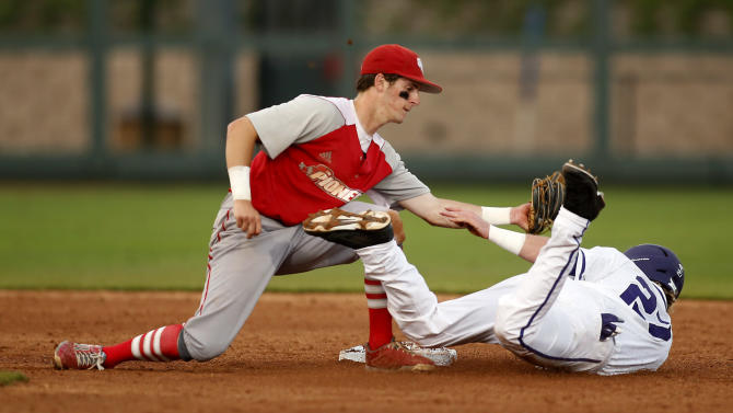 Sacred Heart infielder Zack Short, left, tags out TCU's Evan Williams in the fourth inning at the Fort Worth Regional of the NCAA college baseball tournament  in Fort Worth, Texas, on Friday, May 29, 2015.  (AP Photo/Brad Loper)