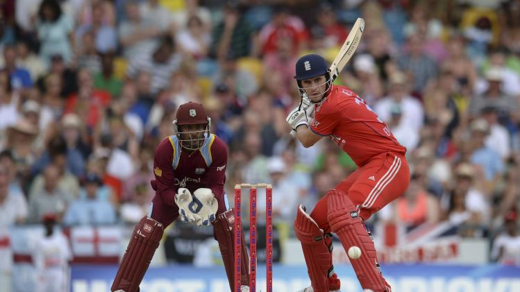 England's Hales prepares to hit the ball watched by West Indies' Ramdin during their second T20 international cricket match in Barbados