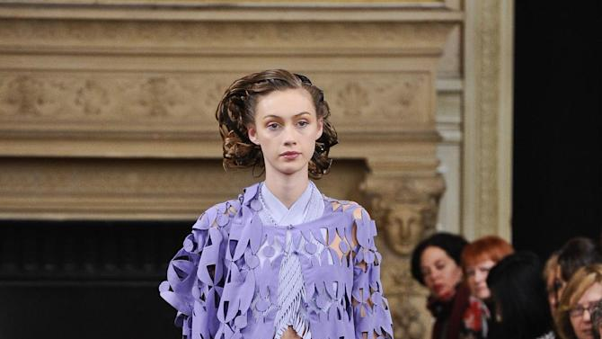 A model wears a creation by fashion designer Maurizio Galante as part of his Spring/Summer 2013 Haute Couture fashion collection, presented in Paris, Monday, Jan. 21, 2013. (AP Photo/Zacharie Scheurer)