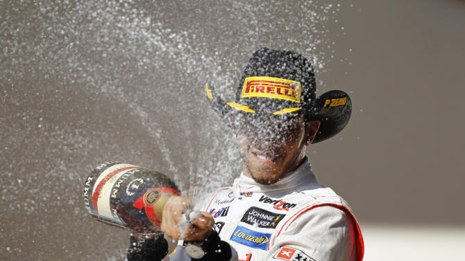 McLaren Formula One driver Hamilton of Britain sprays champagne during the podium ceremony after winning the U.S. F1 Grand Prix in Austin