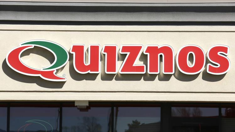 The sign outside a Quiznos store is seen in Westminster, Colorado