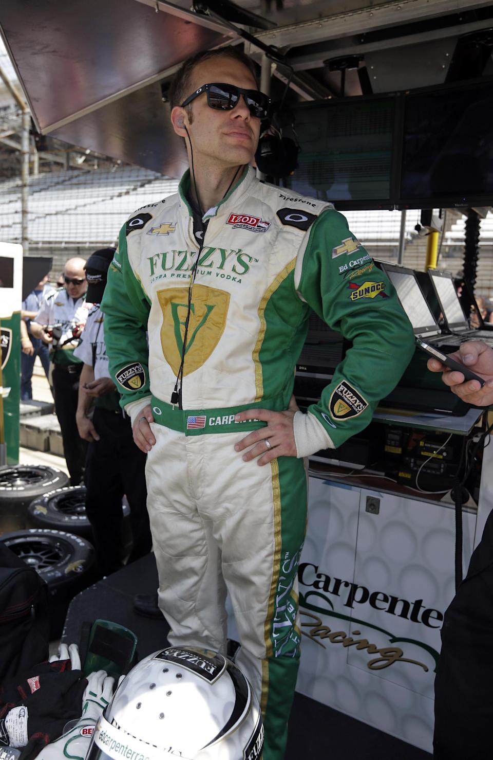 Ed Carpenter prepares to practice on the second day of qualifications for the Indianapolis 500 auto race at the Indianapolis Motor Speedway in Indianapolis, Sunday, May 19, 2013. Carpenter will start the race from the pole. (AP Photo/Darron Cummings)