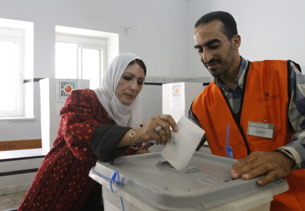Palestinian Maysoun Qawasmi, a candidate at the municipal elections and leading the women-only list, casts her ballot in the West Bank city of Hebron, Saturday Oct 20, 2012 . Palestinians in the West Bank voted in local elections in what was the first time they had gone to the polls since 2006. (AP Photo/Nasser Shiyoukhi)