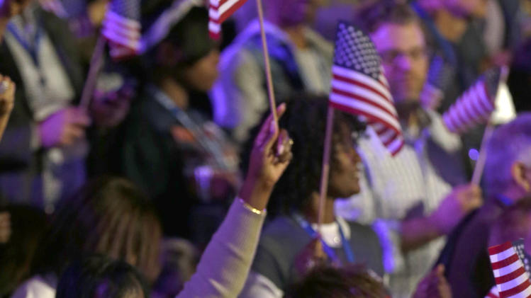 Supporters wave flags at the election night party for President Barack Obama as they watch the returns Tuesday, Nov. 6, 2012, in Chicago. (AP Photo/Pablo Martinez Monsivais)