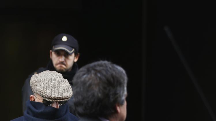 Juan Antonio Gonzalez Pacheco (in glasses), a former police inspector during the Franco regime, leaves Madrid's High Court after appearing before judge Pablo Ruz on preliminary proceedings for extradition to Argentina