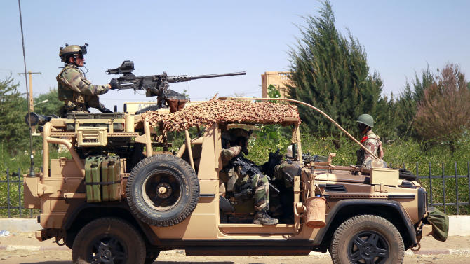 French special forces drive through the city of Gao, Northern Mali, Wednesday Jan. 30, 2013. Islamist extremists fled the city Saturday after French, Chadian and Nigerien troops arrived, ending 10 months of radical islamic control over the city.(AP Photo/Jerome Delay)