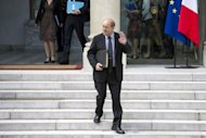 <p>French Defence Minister Jean-Yves Le Drian, pictured on June 6, is due to travel to Afghanistan on Sunday hours after an attack that killed four French soldiers and an announcement that the nation would begin withdrawing troops in July.</p>