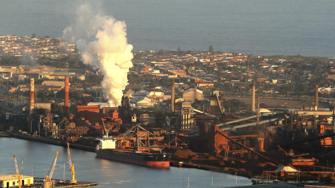 FILE - In this July 2, 2014 file photo, smoke billows out of a chimney stack of steel works factories in Port Kembla, south of Sydney. Australia's government repealed a much-maligned carbon tax on the nation's worst greenhouse gas polluters on Thursday, July 17, 2014, ending years of contention over a measure that became political poison for the lawmakers who imposed it. The Senate voted 39 to 32 to axe the 24.15 Australian dollar ($22.60) tax per metric ton of carbon dioxide that was introduced by the center-left Labor government in July 2012. (AP Photo/Rob Griffith, File)