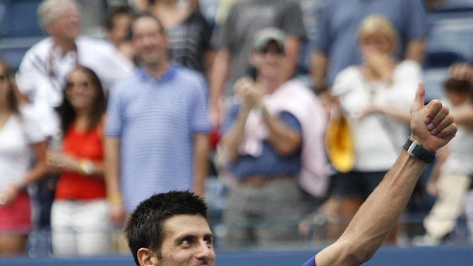 Serbia's Novak Djokovic celebrates winning his match against Julien Benneteau, of France, in the third round of play at the 2012 US Open tennis tournament,  Sunday, Sept. 2, 2012, in New York. (AP Photo/Mel C. Evans)