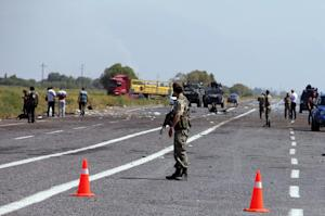Forensic officers investigate after a roadside bomb…
