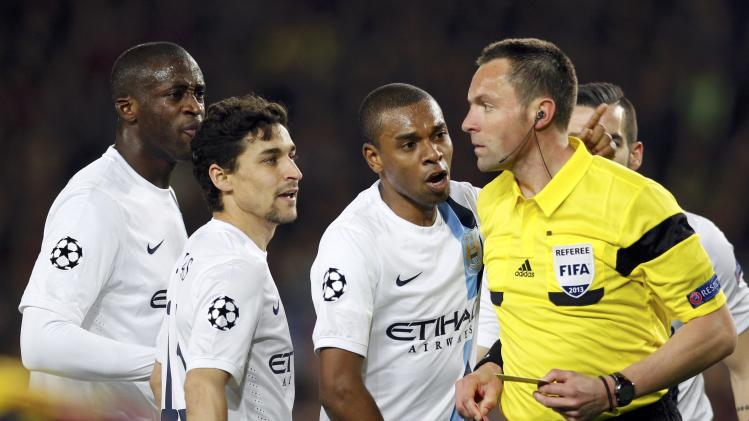 Manchester City's Yaya Toure, Navas and Fernandinho argue with referee Lannoy before he expelled teammate Zabaleta during their Champions League last 16 second leg soccer match against Barcelona