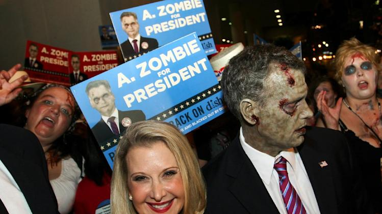 A pack of attendees dressed as zombies walk the streets at Dragon Con in Atlanta, on Friday, Aug. 31, 2012. The annual science fiction and fantasy convention drew big crowds and had more than 30,000 pre-registered attendees. (AP Photo/Ron Harris)