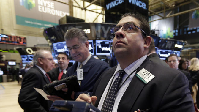 Robert Oswald, right, works with fellow traders work on the floor of the New York Stock Exchange Friday, Nov. 22, 2013. Stocks were mixed in early trading Friday as traders and investors lacked a catalyst to push the major indexes higher after strong gains this year. (AP Photo/Richard Drew)