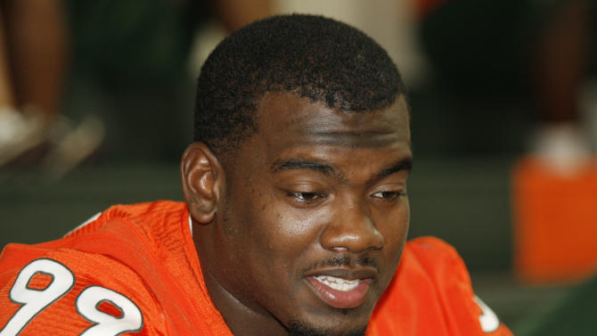 FILE - This Aug. 27, 2011 file photo shows Miami's Marcus Forston answering questions during NCAA college football media day in Coral Gables, Fla. Miami has lost Forston for the remainder of the season because of a knee injury, the latest blow in an already-tough season for the Hurricanes. The team announced Forston's injury early Thursday, Oct. 6, 2011.  (AP Photo/Jeffrey M. Boan)