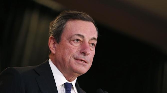 Draghi, President of the European Central Bank, addresses the Economic Club of New York luncheon in New York City