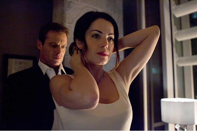 "Michael Shanks as Dr. Charlie Harris and Erica Durance as Dr. Alex Reid in ""Saving Hope."""