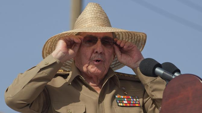 Cuba's President Raul Castro puts his sunglasses as he begins his speech at an event celebrating Revolution Day in Santiago, Cuba, Friday, July 26, 2013. Cuba marks the 60th anniversary of the July 26, 1953 rebel attack led by Fidel and Raul Castro on the Moncada military barracks. The attack is considered the beginning of the revolution that culminated with dictator Fulgencio Batista's ouster. (AP Photo/Ramon Espinosa)