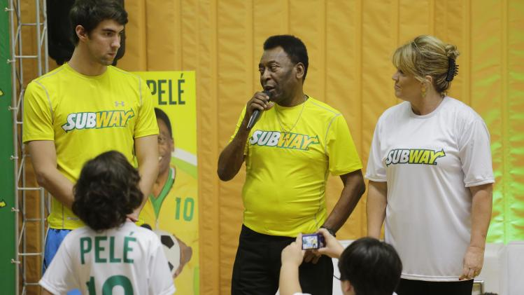 Former U.S. Olympic Swimmer Michael Phelps, left, and Brazilian soccer legend Pele answer questions from children at Competition academy, during a event organized by SUBWAY restaurants, on Wednesday, Dec. 4, 2013 in Sao Paulo, Brazil. (Photo by Nelson Antoine/Invision for SUBWAY Restaurants/AP Images)