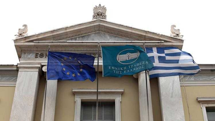 Flags from right: Greek, National Bank of Greece and the European Union flags fly outside the headquarters of the National Bank of Greece, in Athens, on Tuesday, May 29, 2012. The four biggest Greek banks received 18 billion euros (US$22.6 billion) in rescue funds on May 28, 2012 to help reinforce their capital bases, a Hellenic financial stability fund source said. National Bank, the biggest Greek lender, has received 7.43 billion euros, Piraeus bank 4.7 billion euros, Eurobank 3.97 billion euro and Alpha 1.9 euros billion, the official said.(AP Photo/Petros Giannakouris)