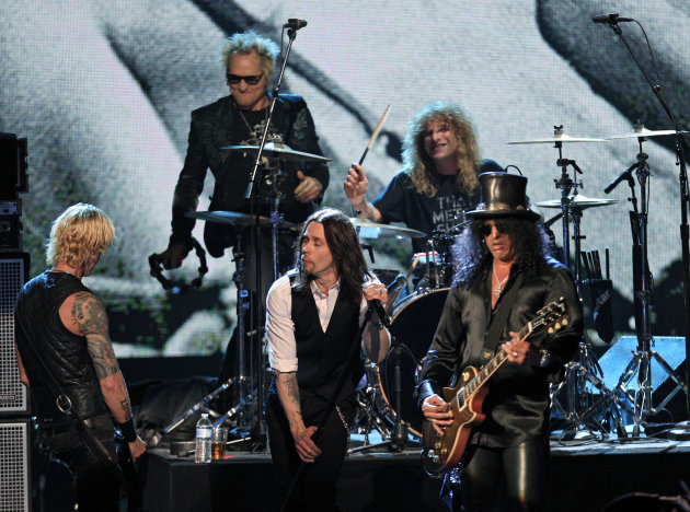Guns N&#39; Roses&#39; Duff McKagan, left, Matt Sorum, top left, Steven Adler, top right, and Slash, right, perform with guest vocalist Myles Kennedy after induction onto the Rock and Roll Hall of Fame Sunday, April 15, 2012, in Cleveland. (AP Photo/Tony Dejak)