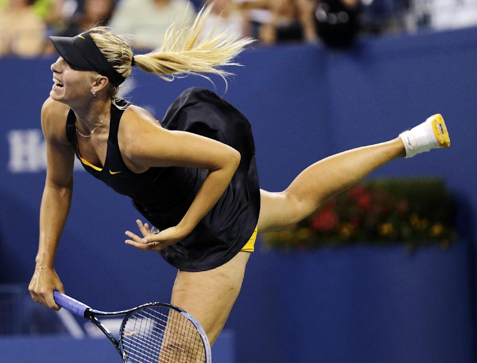 Maria Sharapova, of Russia, serves to Lourdes Dominguez Lino, of Spain, in the second round of play at the U.S. Open tennis tournament, Wednesday, Aug. 29, 2012, in New York. (AP Photo/Charles Krupa)
