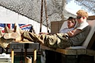 This picture taken on November 2, 2012 shows Britain's Prince Harry relaxing with fellow pilots in their VHR (very high ready-ness) area at Camp Bastion in Afghanistan's Helmand Province. Harry said he killed Taliban fighters during his stint as a helicopter gunner in Afghanistan, in comments that can be reported after he completed his tour of duty Monday.