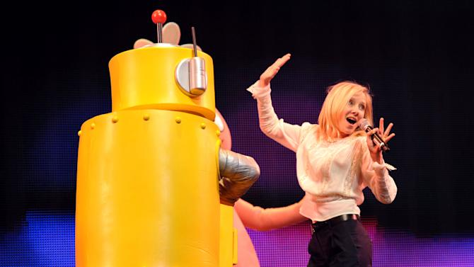 IMAGE DISTRIBUTED FOR GABBA CA DABRA - Anne Heche, right, and Plex appear on stage at Yo Gabba Gabba! Live!: Get The Sillies Out! 50+ city tour kick-off performance on Thanksgiving weekend at Nokia Theatre L.A. Live on Friday Nov. 23, 2012 in Los Angeles. (Photo by John Shearer/Invision for GabbaCaDabra, LLC./AP Images)