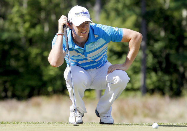 Rory McIlroy, of Northern Ireland, lines up a putt on the fourth hole during the final round of the Deutsche Bank Championship PGA golf tournament at TPC Boston in Norton, Mass., Monday, Sept. 3, 2012. (AP Photo/Michael Dwyer)