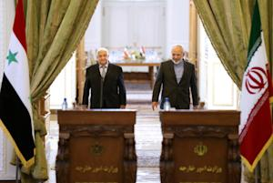 Iranian Foreign Minister Mohammad Javad Zarif, right, …