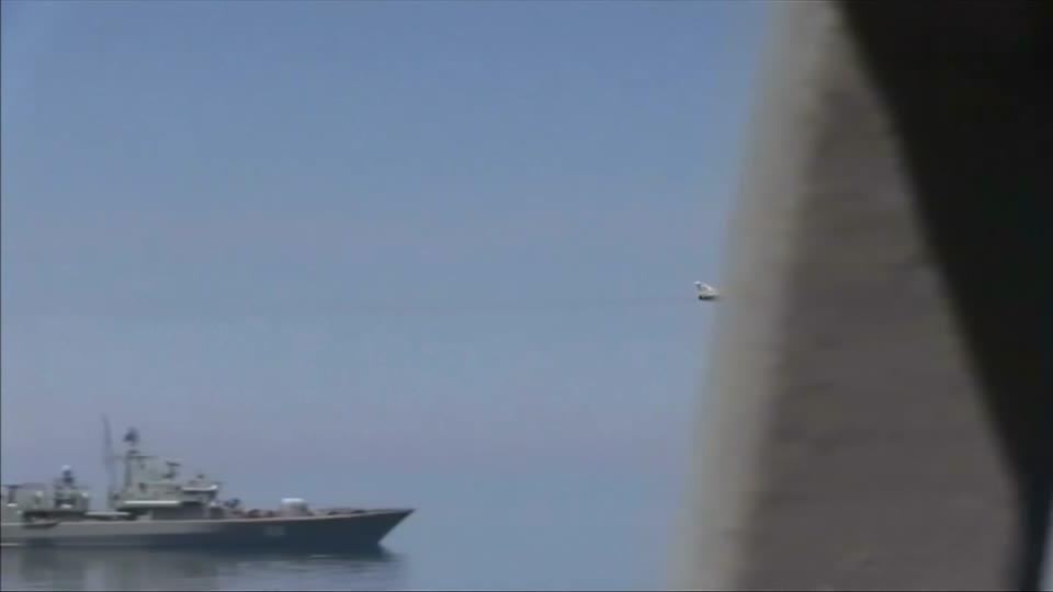 Russian aircraft try to head off U.S. warship in Black Sea