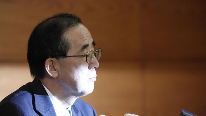 Bank of Japan Governor Shirakawa speaks during a news conference in Tokyo