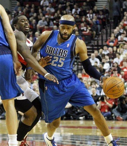 Nowitzki, West lead Mavs past Blazers, 97-94