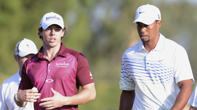USA's Tiger Woods, right, and Rory McIlroy of Northern Ireland speak as they walk on the course before  their World Golf Final Group 1 match in Belek, Antalya, Turkey, Thursday, Oct. 11, 2012. (AP Photo)
