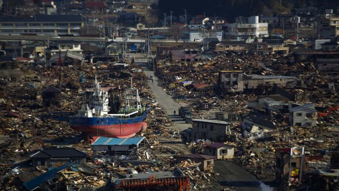 FILE - In this March 28, 2011 file photo, a ship sits in a destroyed residential neighborhood in Kesennuma, Japan. The tsunami that slammed into Japan's coastline last year flung boats onto roofs, washed away homes and left this major fishing port a shell of its former self. The disaster killed around 19,000 people. (AP Photo/David Guttenfelder, File)