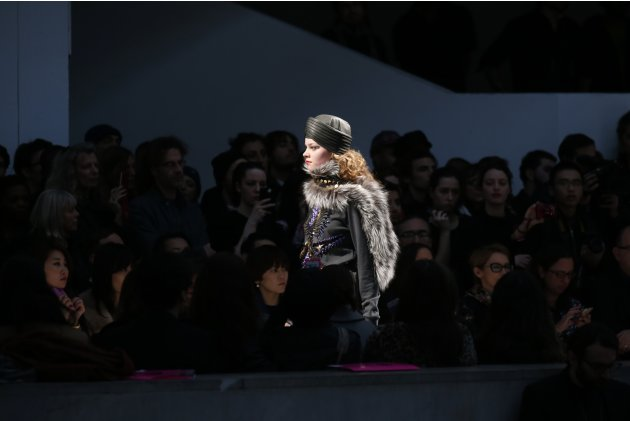 A model presents a creation by Indian designer Manish Arora as part of his Fall-Winter 2013/2014 women's ready-to-wear fashion show in Paris