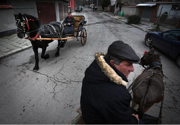 Bulgarians ride their horse-drawn carts during celebrations of Todorov Den, also called Horse Easter, in the Bulgarian village of Mramor near the capital Sofia, Saturday, March 8, 2014. By tradition,
