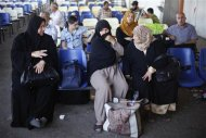 Stranded Palestinian passengers wait at Rafah crossing between Egypt and southern Gaza Strip, with hopes of crossing into Egypt September 12, 2013. REUTERS/Ibraheem Abu Mustafa