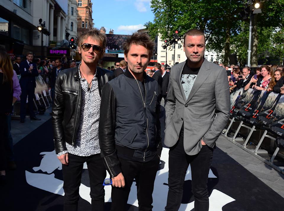 Muse members from left Dominic Howard, Matthew Bellamy and Christopher Wolstenholme arrive at The World Premiere of 'World War Z' at the Empire Cinema in London on Sunday June 2nd, 2013. (Photo by Jon Furniss/Invision/AP Images)
