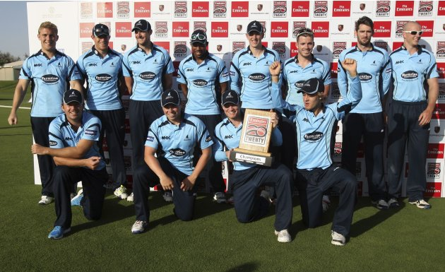 The Sussex Sharks team pose with their trophy after winning the Emirates Twenty20 final cricket match against Fly Emirates XI in Dubai