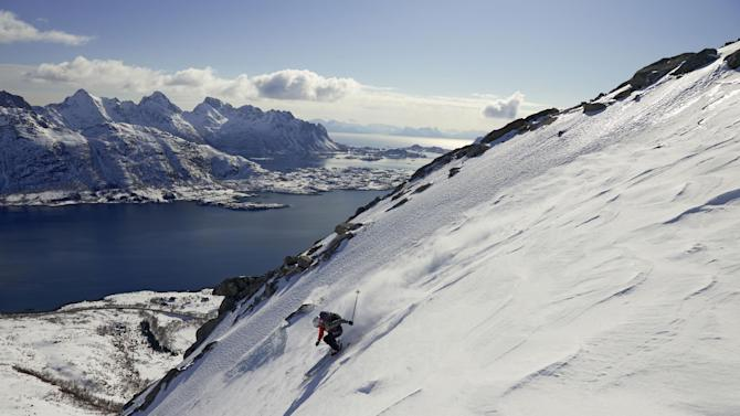 IMAGE DISTRIBUTED FOR MAMMUT - Danish freestyle skier Anja Bolbjerg skies down to sea level from the top of Mount Geitgaljen in the Lofoten region of Norway in April, 2012. Bolbjerg skied down the mountain as part of Mammut's 'Biggest Peak Project in History' to celebrate the company's 150th anniversary as an alpine equipment provider. (Rainer Eder/Photopress for Mammut via AP Images) MANDATORY CREDIT