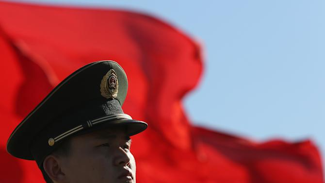 A Chinese paramilitary policeman stands guard on Tiananmen Square while sessions of the National People's Congress and the Chinese People's Political Consultative Conference are held at the Great Hall of the People in Beijing Monday, March 4, 2013. The National People's Congress, which opens Tuesday, completes the leadership power transition initiated four months ago, approving top government appointments and giving the new leaders a platform to lay out policies. (AP Photo/Kin Cheung)