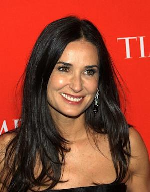 Demi Moore is walking away.