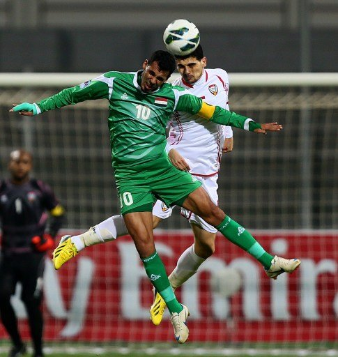 Emirati Mohannad Salem (R) vies for the ball against Younis Mahmoud of Iraq during their 21st Gulf Cup football match final in Manama, on January 18, 2013. AFP PHOTO/MARWAN NAAMANI