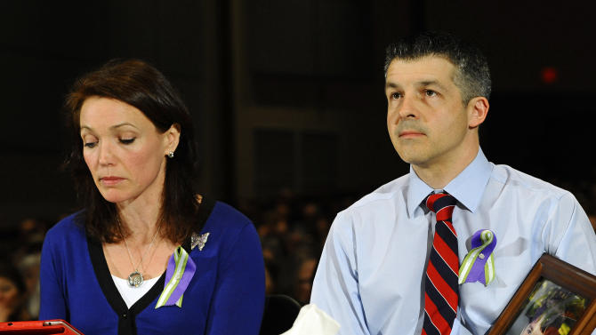 Nicole and Ian Hockley, parents of Sandy Hook School shooting victim Dylan, testify during a hearing of a legislative task force on gun violence and children's safety at Newtown High School in Newtown, Conn., Wednesday, Jan. 30, 2013. Connecticut lawmakers are in Newtown for the hearing, where those invited to give testimony include first responders and families with children enrolled at Sandy Hook Elementary. (AP Photo/Jessica Hill)